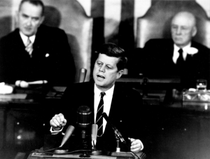 "President Kennedy delivering the his famous ""Moonshot Speech."""