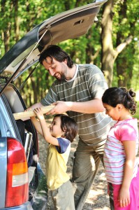 Family with car in nature
