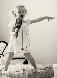 kid singing hairbrush